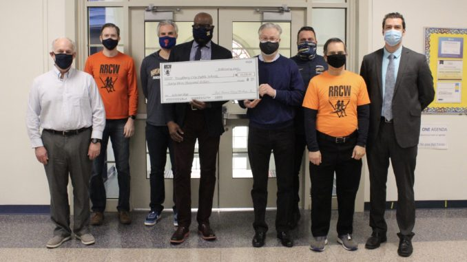 RRCW presents a check to Woodbury High School